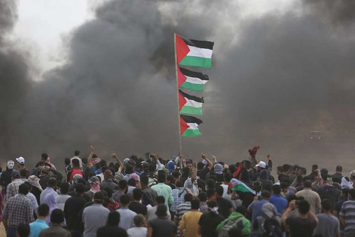 Filistin Halkına Yapılan Katliamı Lanetliyor ve Kınıyoruz